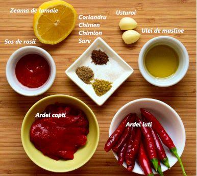 Ingrediente harissa: ardei iuti rosii, ardei rosii copti, sos simplu de rosii, zeama de lamaie, usturoi, ulei de masline, chimen, chimion, coriandru, sare
